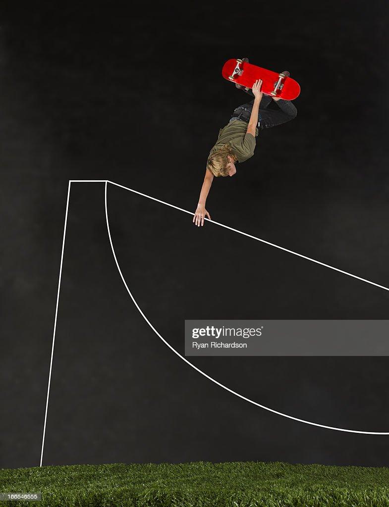 Teenage boy (14-15) skateboarding in half pipe : Stock Photo