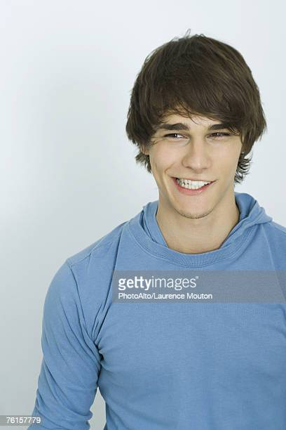 'Teenage boy smirking, portrait'