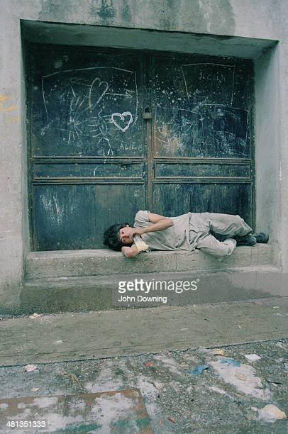 A teenage boy sniffing glue in a slum area of Rio de Janeiro Brazil circa 1990