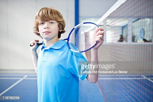 Teenage boy standing on badminton court