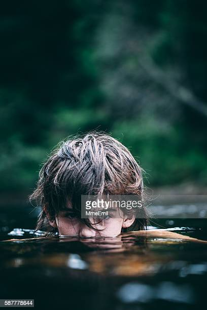 Teenage Boy Submerge In A Dark Lake