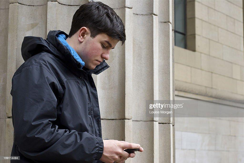 Teenage boy texting : Stock Photo