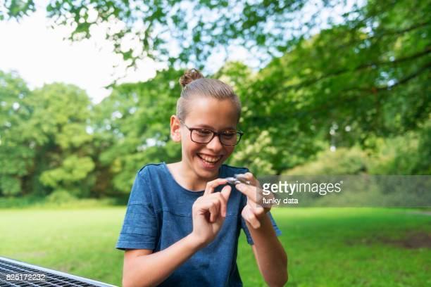 Teenage boy using hand spinner
