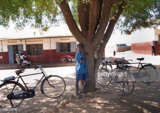 A teenage boy waits for epilepsy medication to deal with symptoms of a mystery ailment known as nodding disease outside the Pajimu health centre in...