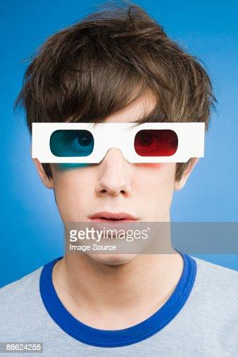 A teenage boy wearing 3d glasses