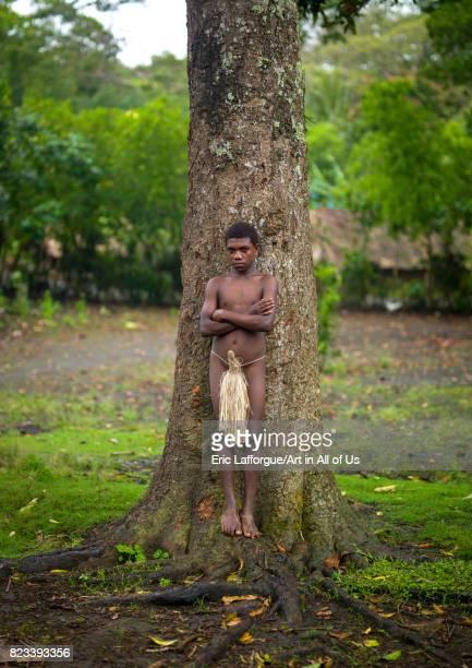 Teenage boy wearing a penis sheath called a namba Tanna island Yakel Vanuatu on September 6 2007 in Yakel Vanuatu