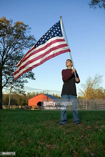 Teenage boy with American flag