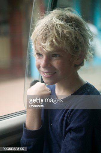 Teenage Boy With Blonde Hair Sitting In Car Portrait Stock ...