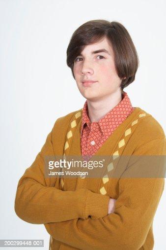 Teenage boy (15-17) with bob haircut, arms folded, portrait : Stock-Foto