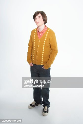 Teenage boy (15-17) with bob haircut, hands in pockets, portrait : Stock-Foto