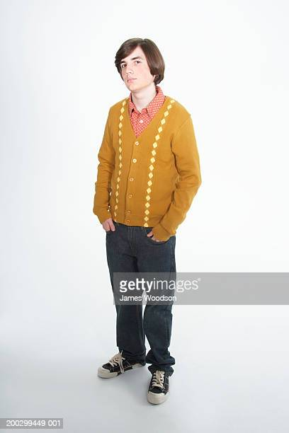 Teenage boy (15-17) with bob haircut, hands in pockets, portrait