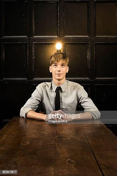 Teenage boy with lightbulb on head