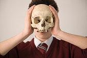 Teenage boy with skull