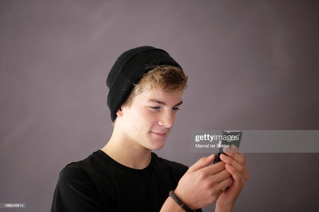 Teenage boy with smartphone
