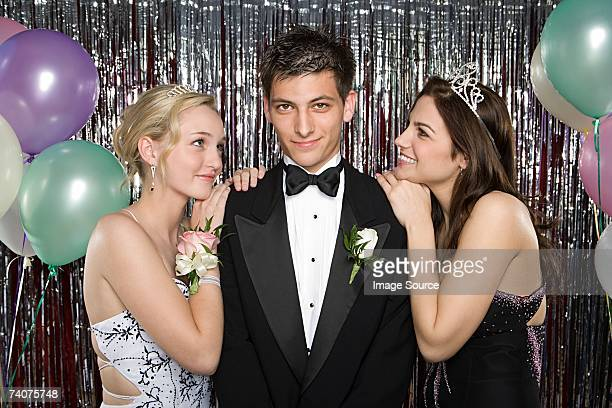 Teenage boy with two girls at prom
