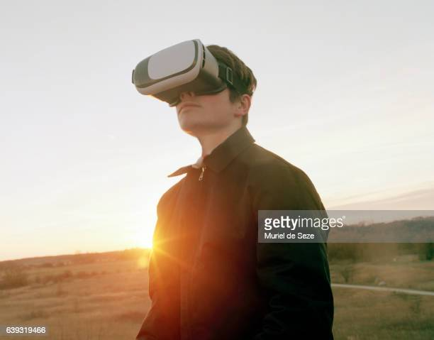 Teenage boy with Virtual Reality goggles
