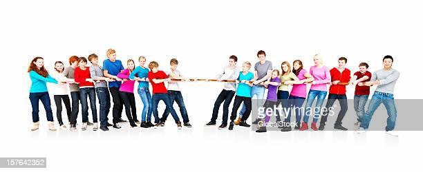 Teenage boys and girls playing tug of war