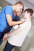 Teenage boys bullying their classmate.