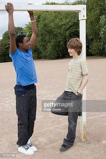 Teenage boys by goalpost