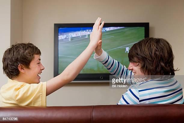 Teenage boys celebrating soccer match