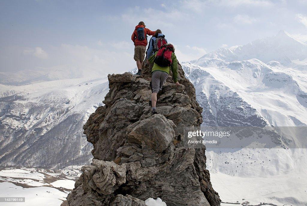 Teenage boys climbing to mountain summit : Stock Photo