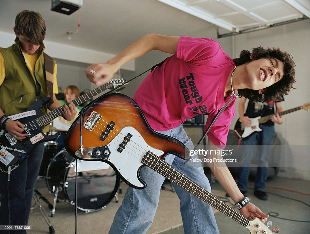 Teenage boys (15-17) in band practicing in garage : Stock Photo