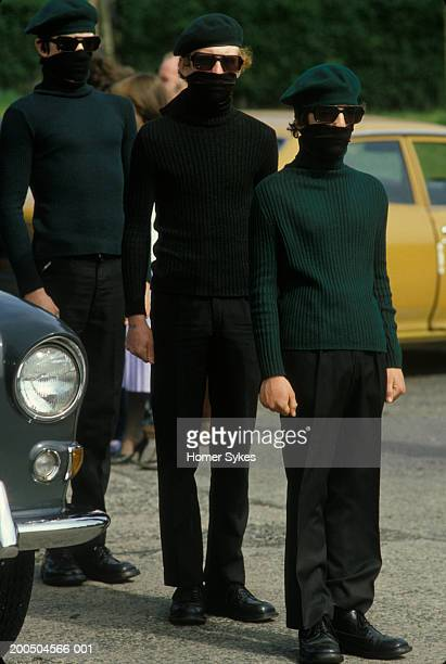 Teenage boys parade dressed in the green uniform of the INLA Irish National Liberation Army during the Troubles