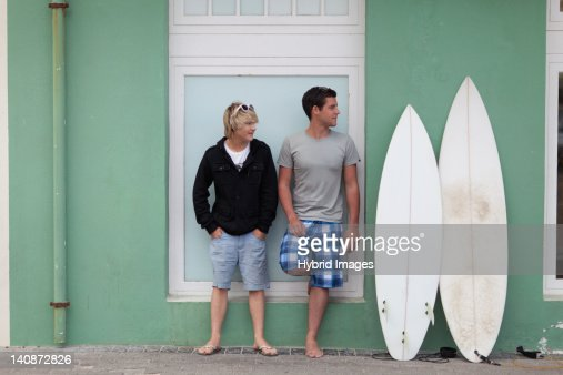 Teenage boys standing with surfboards : Stock Photo