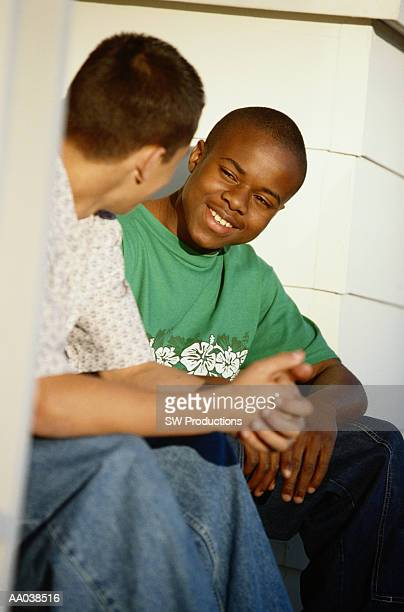 Teenage boys (13-15) talking