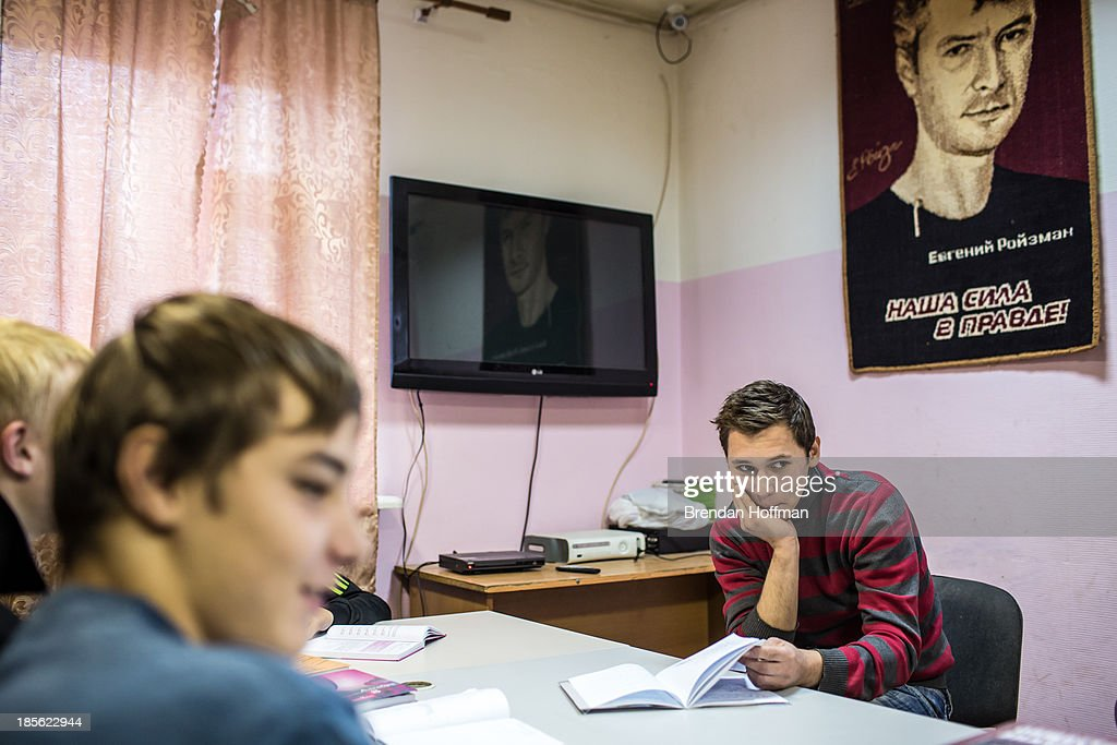 Teenage boys who live at a facility run by City Without Drugs for at-risk youth do their homework underneath a picture of founder Yevgeny Roizman on October 16, 2013 in Yekaterinburg, Russia. Nine boys, many of whom were either experimenting with drugs or had dropped out of school, live at the group home, where school attendance and homework are mandatory. City Without Drugs is a well-known narcotics treatment program in Russia founded by Yevgeny Roizman, who was elected mayor of Yekaterinburg in September 2013.
