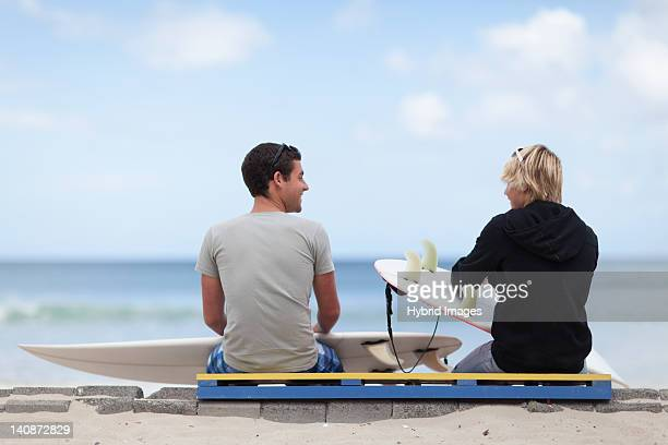 Teenage boys with surfboards on beach