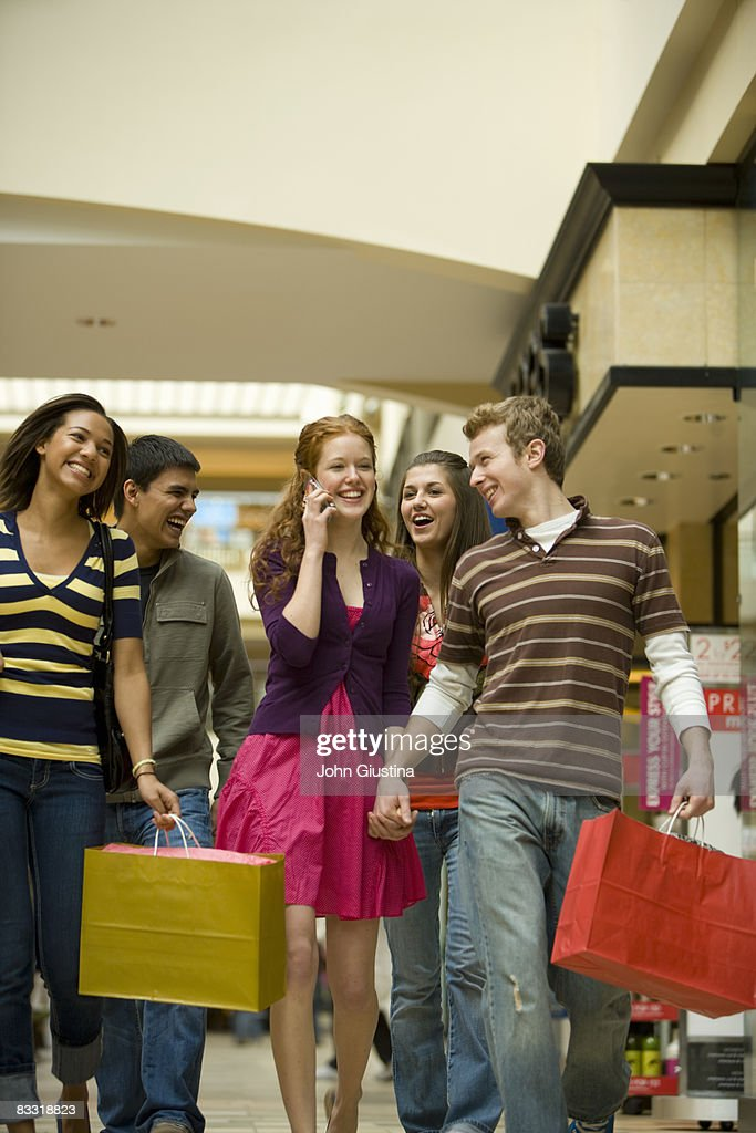 Teenage children (14-17) with shopping bags : Stock Photo