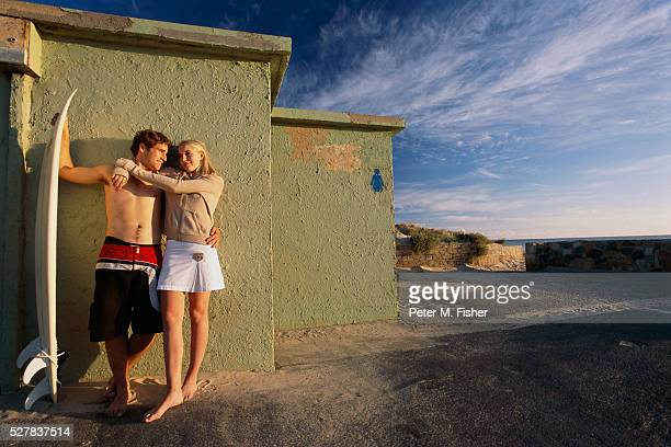Teenage Couple by Changing Rooms at Beach