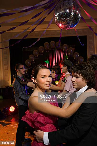 Teenage couple dancing at prom