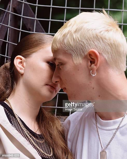 Teenage couple kissing
