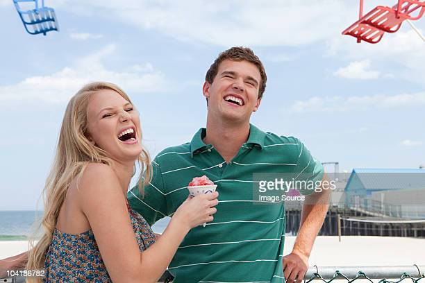 Teenage couple laughing