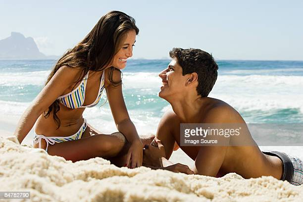 A teenage couple on the beach
