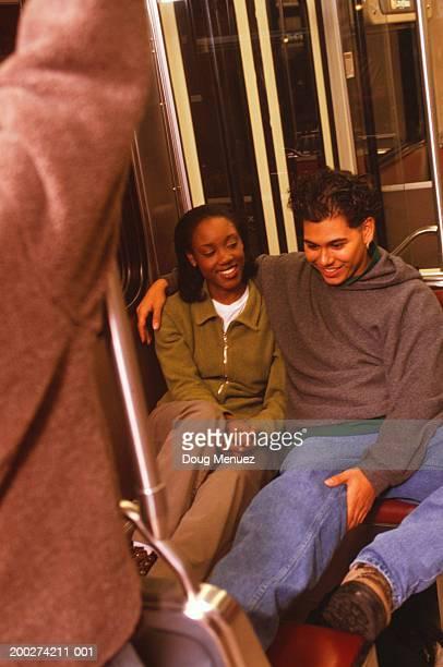 Teenage couple (16-17) on underground train