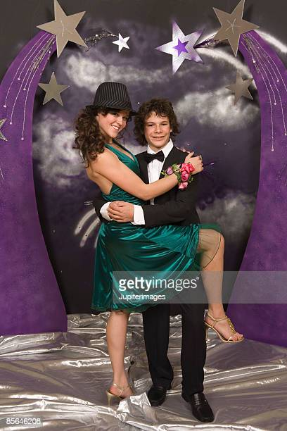 Teenage couple posing for suggestive prom portrait