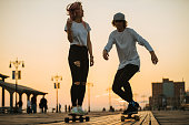Young teenage couple with longboards