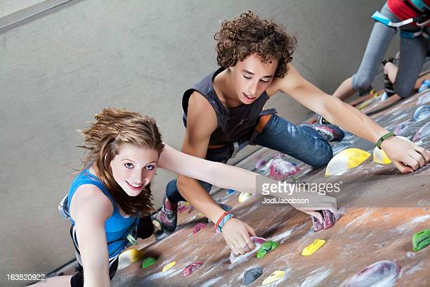 teenage couple rock climbing