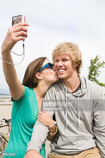 Teenage couple with digital camera