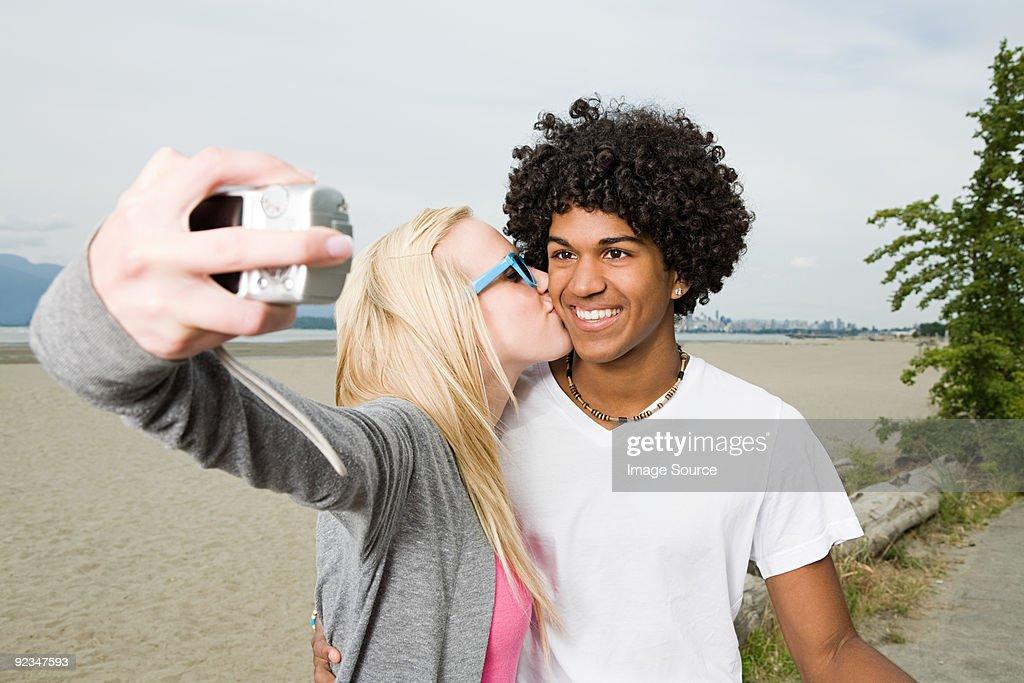 Teenage couple with digital camera : Stock Photo