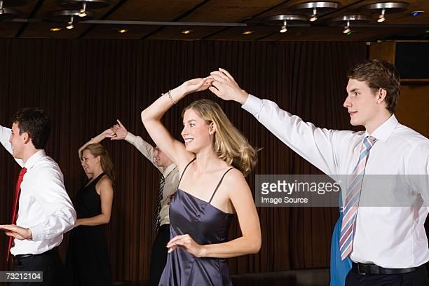 Teenage couples dancing