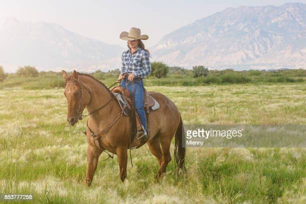 Teenage Cowgirl riding her Horse Utah USA