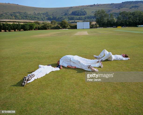Teenage cricket players at the 2006 Bunbury festival relax in the summer sunshine after a long days play The festival was held at Preston Nomads...