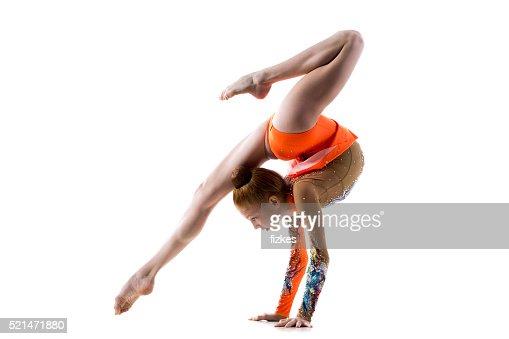 Teenage dancer girl doing handstand : Stock Photo