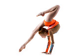 Beautiful gymnast athlete teenage girl wearing dancer colorful leotard working out, dancing, doing backbend, handstand exercise, back walkover, full length, studio, white background, isolated
