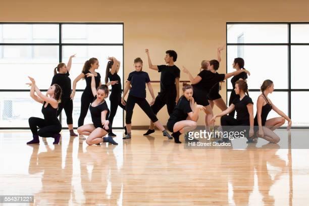 Teenage dancers posing in studio