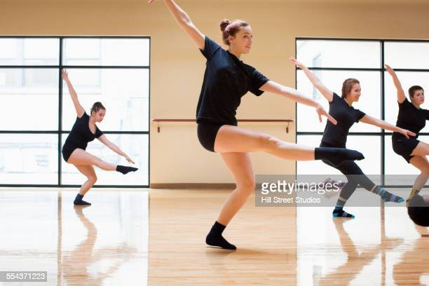 Teenage dancers rehearsing in studio